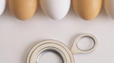 Gadget for the straight cut eggshell. Knife for eggs